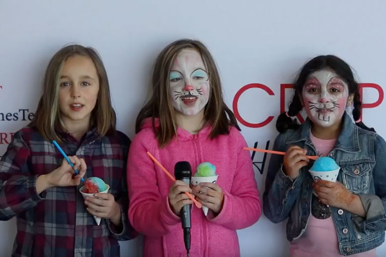 Young girls with snow cones and painted faces - Appreciation Day - Cripps Realty